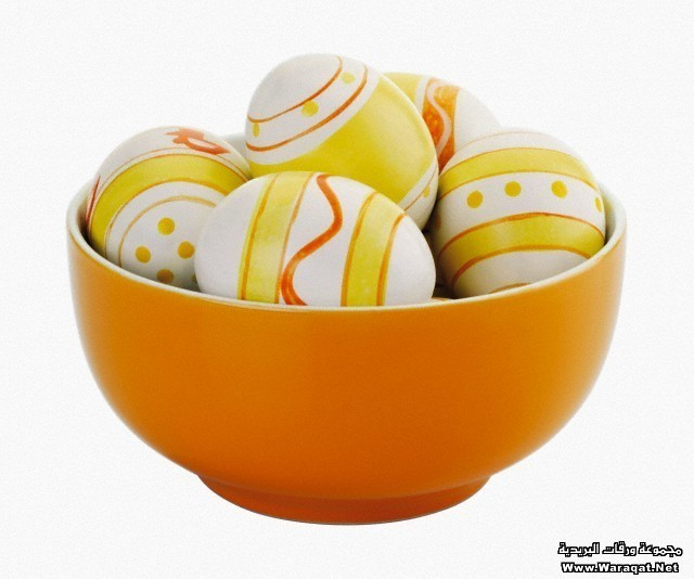 Painted easter eggs in bowl on white background